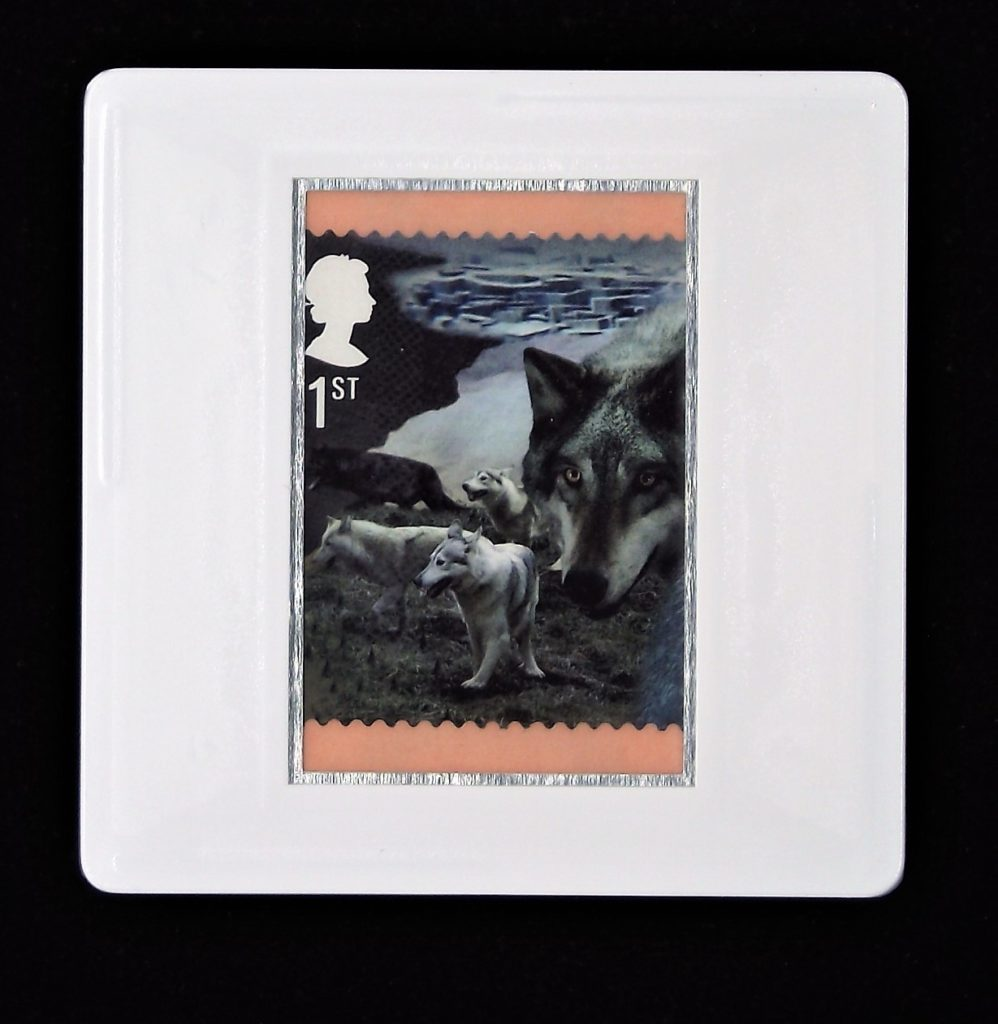 Direwolves and landscape brooch